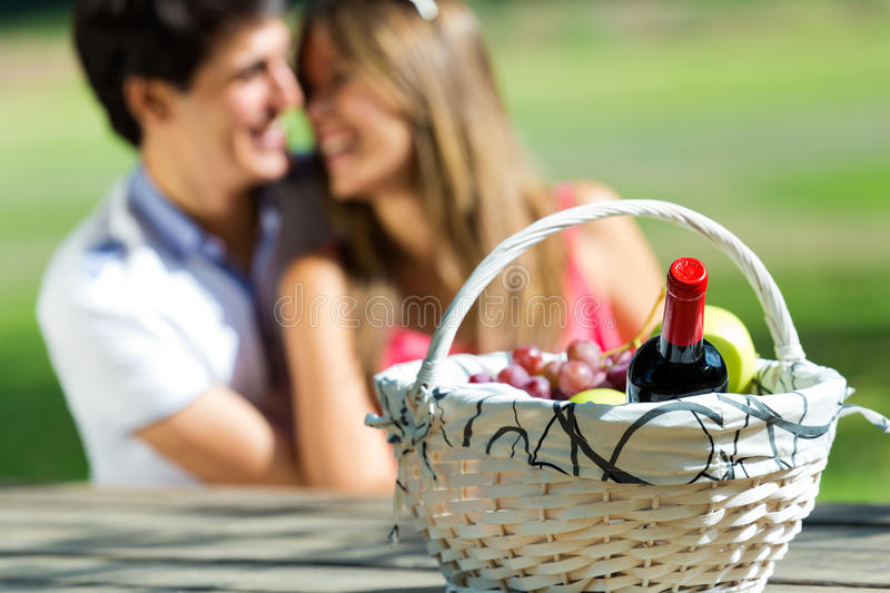 Attractive couple on romantic picnic in countryside. stock images