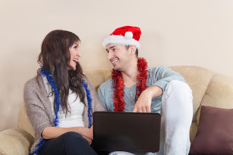 Attractive Couple with Santa Hat Together in Love stock image
