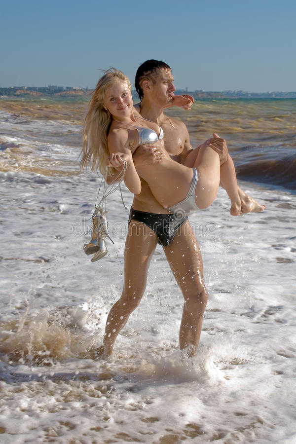 Attractive couple at the sea royalty free stock photo