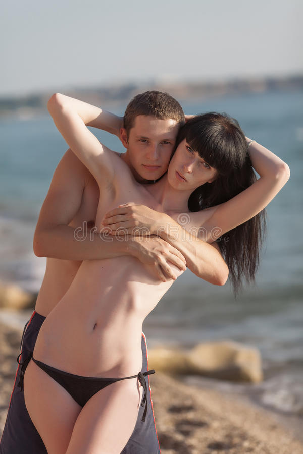 Download Attractive Couple At The Sea Stock Photo - Image: 83707459