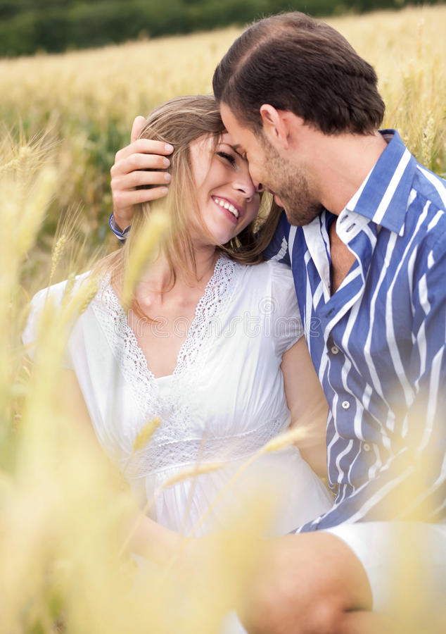 An attractive couple sharing a passionate thoughts. Outdoors stock photos