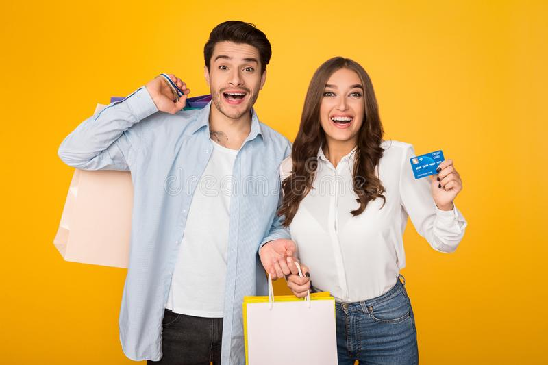 Attractive couple with shopping bags and credit card royalty free stock images