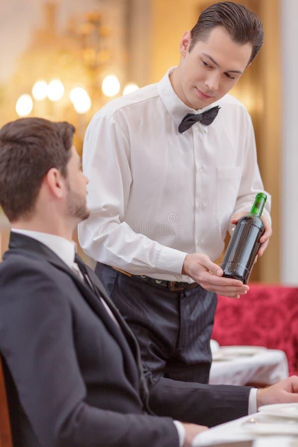 Attractive couple visiting luxury restaurant stock photos