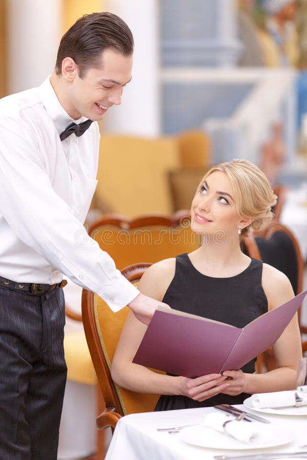 Attractive couple visiting luxury restaurant royalty free stock photography