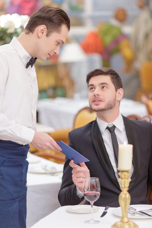 Attractive couple visiting luxury restaurant stock photo
