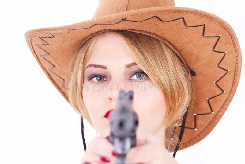Attractive cowboy woman aiming a gun stock photo