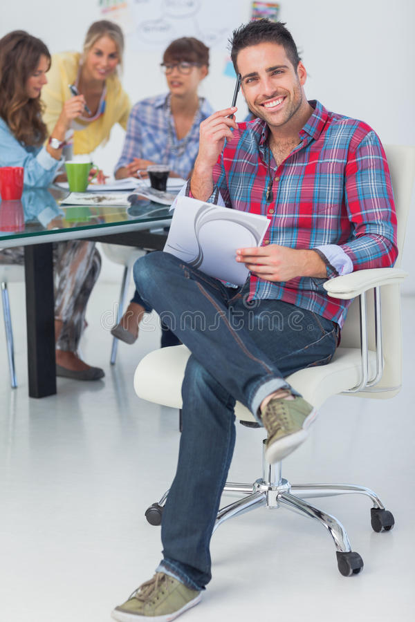 Attractive designer sit in his office royalty free stock photography