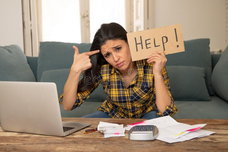 Attractive desperate woman asking for help in managing expenses. Cost living and bill problems royalty free stock photo