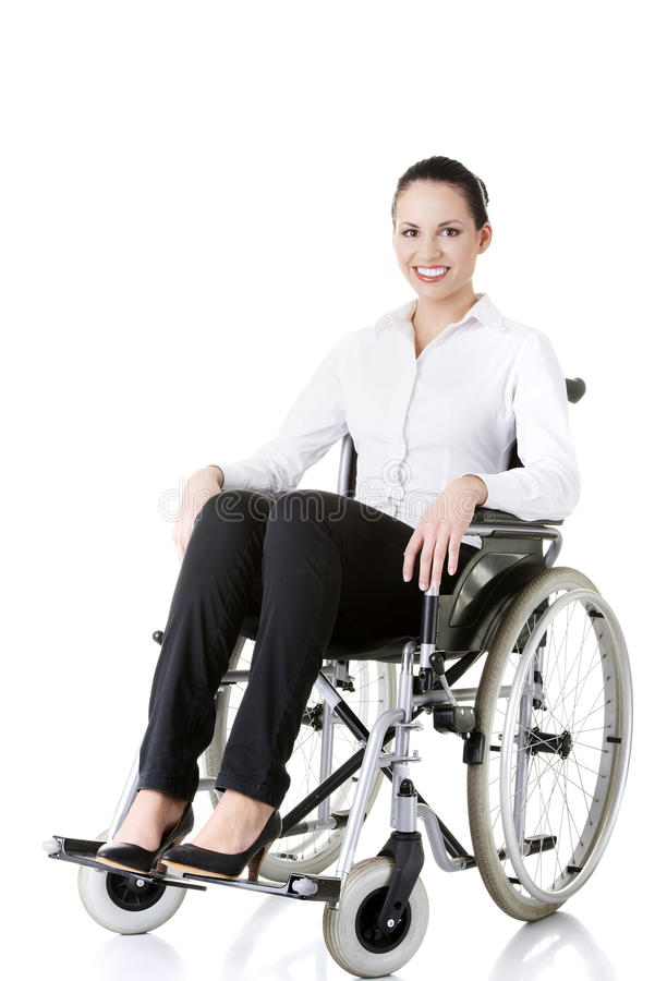 Attractive disabled businesswoman sitting in a wheel chair royalty free stock images