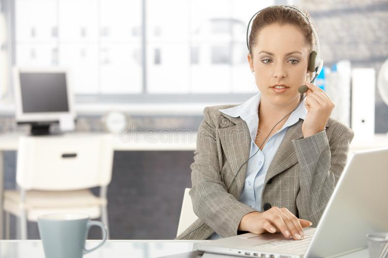 Attractive dispatcher working in bright office stock photography