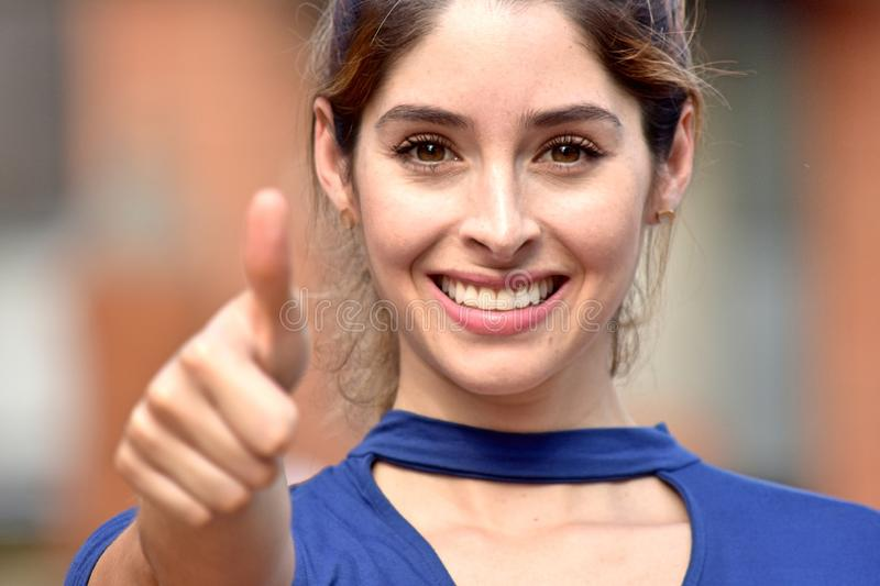 Attractive Diverse Adult Female With Thumbs Up stock images