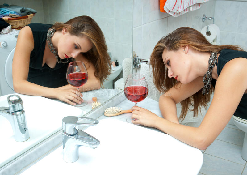 Attractive drunk woman with wine stock photography