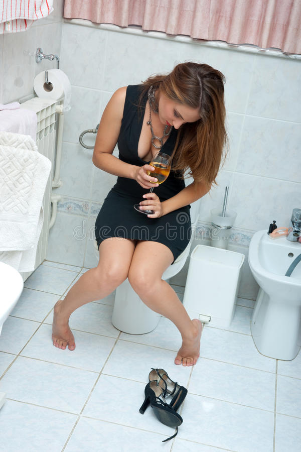 Attractive drunk woman with wine stock image