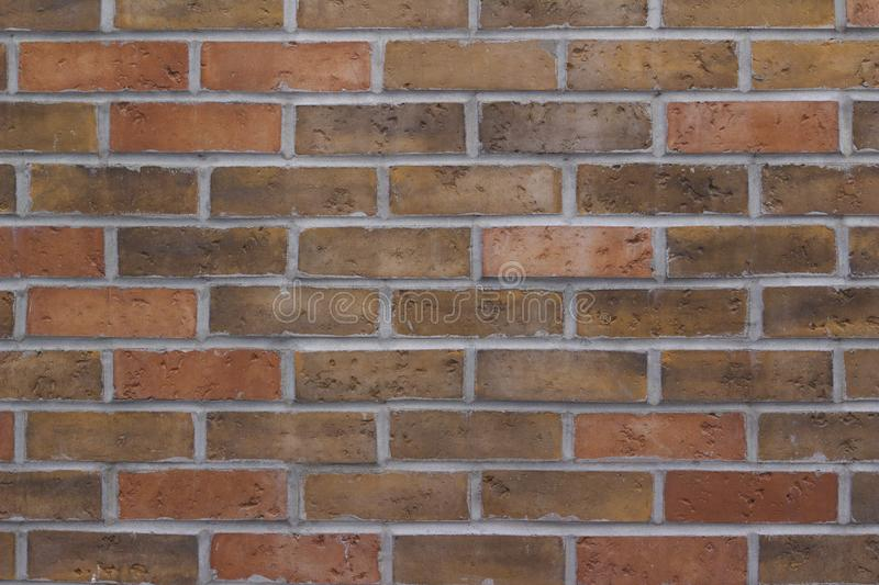 Attractive earth tone brick wall texture background in traditional running bond pattern royalty free stock image