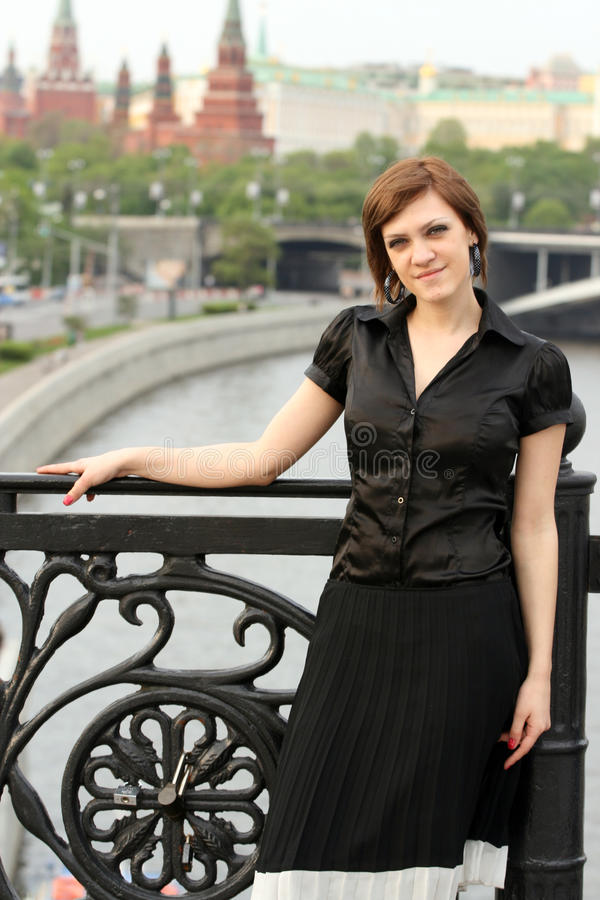 Attractive elegant woman. Posing outdoors. View of Moscow in the background stock image