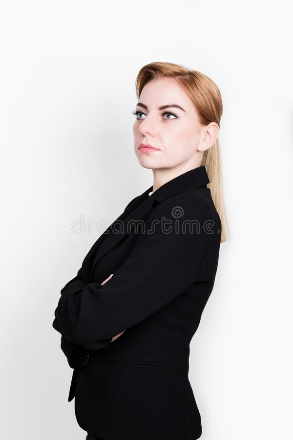 Attractive and energetic business woma in a suit on naked body. Attractive and energetic business woma in a suit on a naked body stock photos