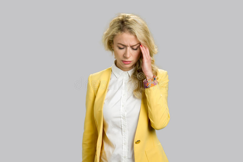 Attractive european woman having headache. royalty free stock images