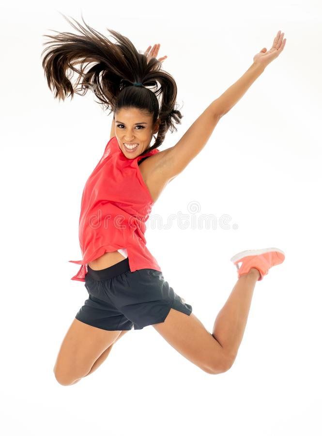 Attractive excited fitness modern dancer girl in sport wear jumping of joy dancing and working out royalty free stock image