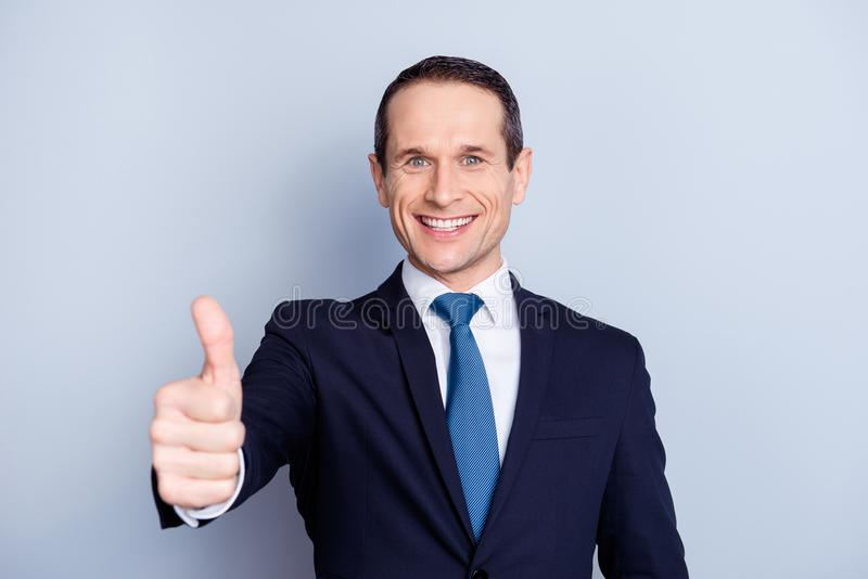Attractive, executive, corporate, fashionable, modern, positive, executive, corporate politician, economist, financier in formal. Wear with tie, showing thumbs stock photography
