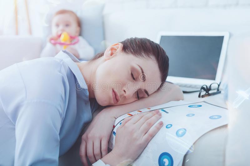 Attractive exhausted woman sleeping stock photography