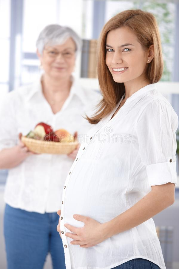 Attractive expectant mother smiling happily