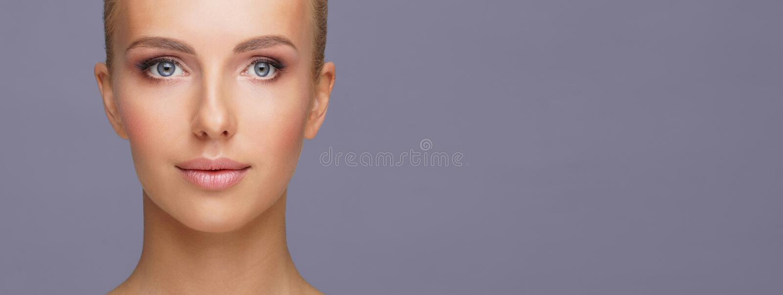 Attractive face of beautiful girl. Close-up portrait of healthy woman. Skin care, cosmetics, makeup, complexion and face royalty free stock images