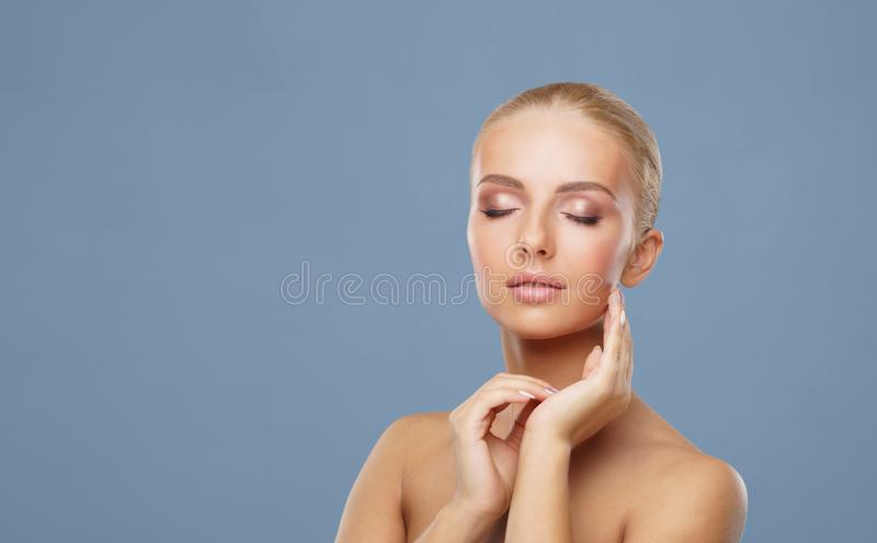 Attractive face of beautiful girl. Close-up portrait of healthy woman. Skin care, cosmetics, makeup, complexion and face royalty free stock photo