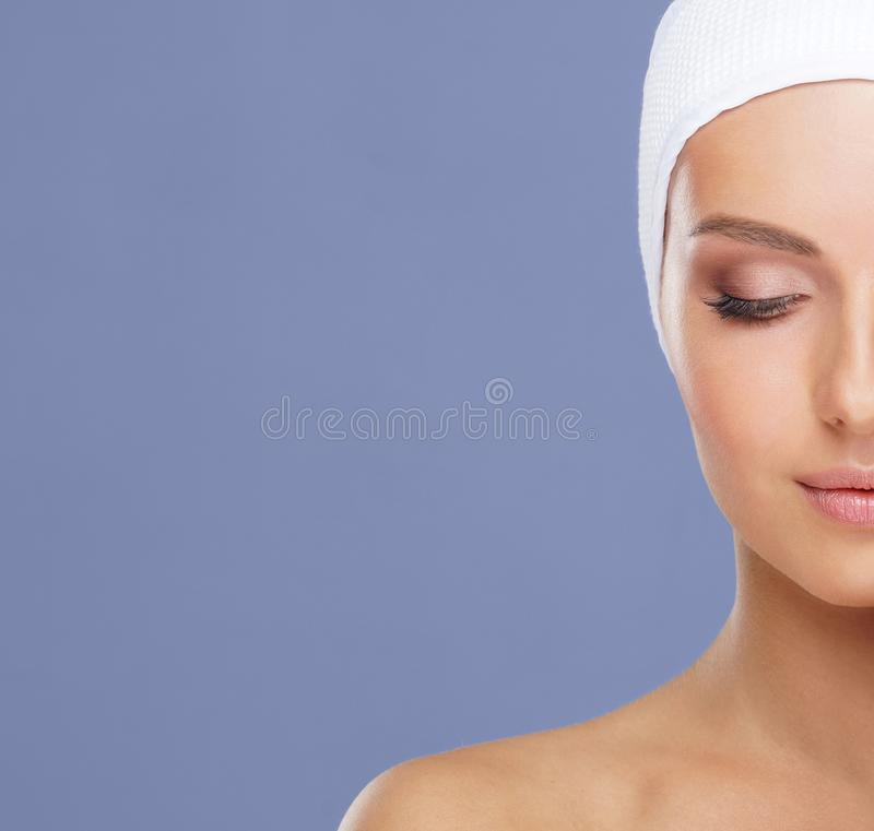 Attractive face of beautiful girl. Close-up portrait of healthy woman. Skin care, cosmetics, makeup, complexion and face royalty free stock photography