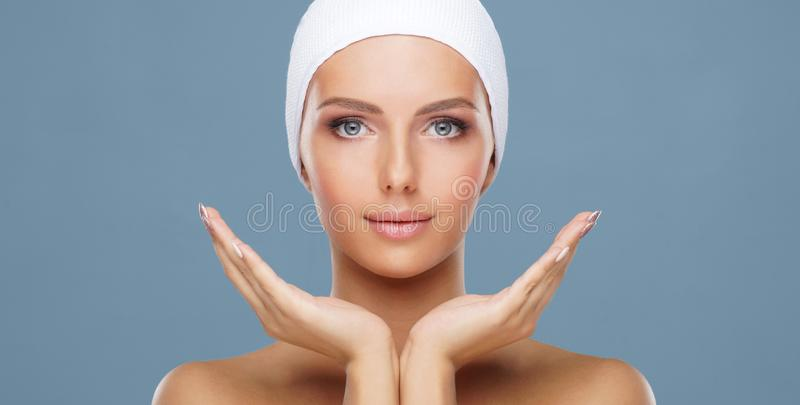 Attractive face of beautiful girl. Close-up portrait of healthy woman. Skin care, cosmetics, makeup, complexion and face stock photo