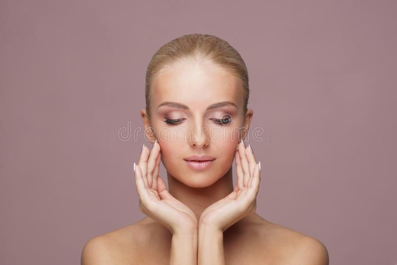 Attractive face of beautiful girl. Close-up portrait of healthy woman. Skin care, cosmetics, makeup, complexion and face royalty free stock photos
