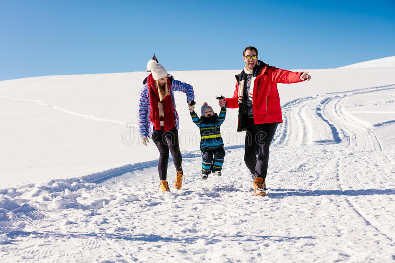 Attractive family having fun in a winter park on mountain.  stock image