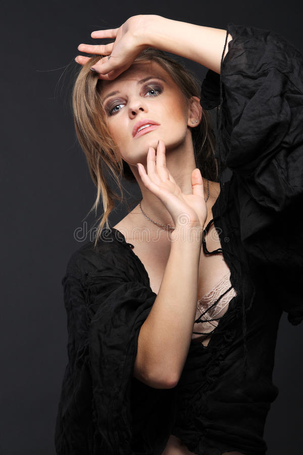 Attractive fashion model on dark background. stock images