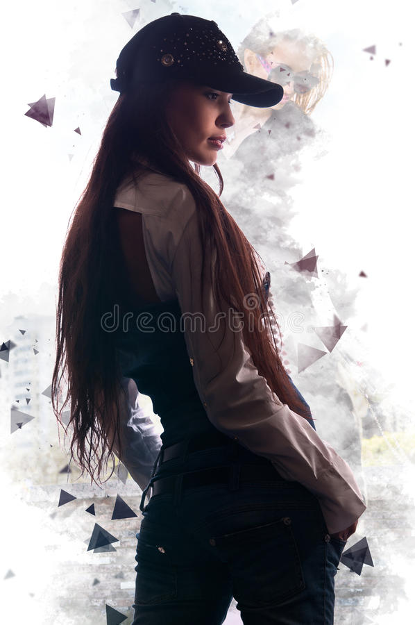 Attractive fashionable girl posing in the background art royalty free stock images