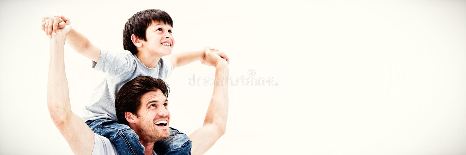 Attractive father giving a piggyback to his son stock photography
