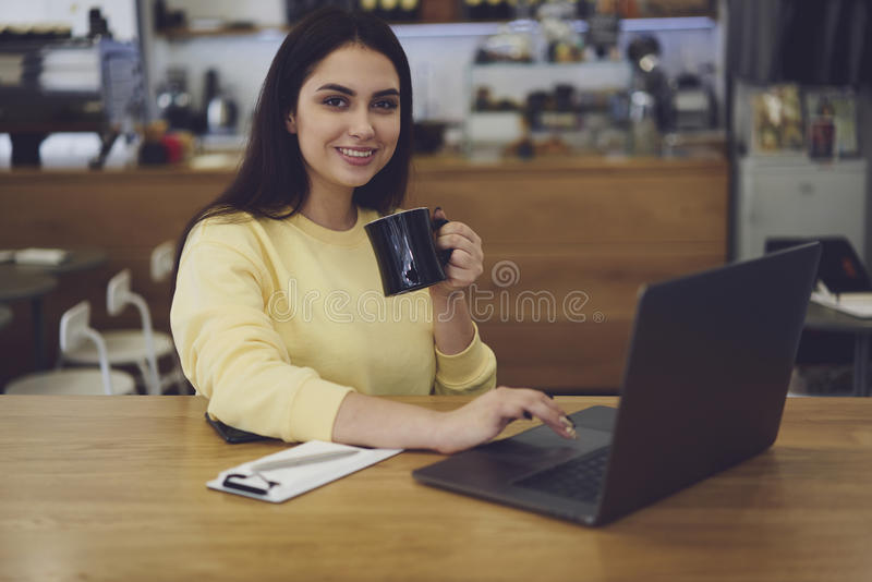 Attractive female administrative manager and free 4G connection in cafeteria royalty free stock photo