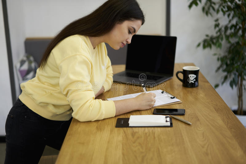 Attractive female administrative manager and modern digital technology stock image