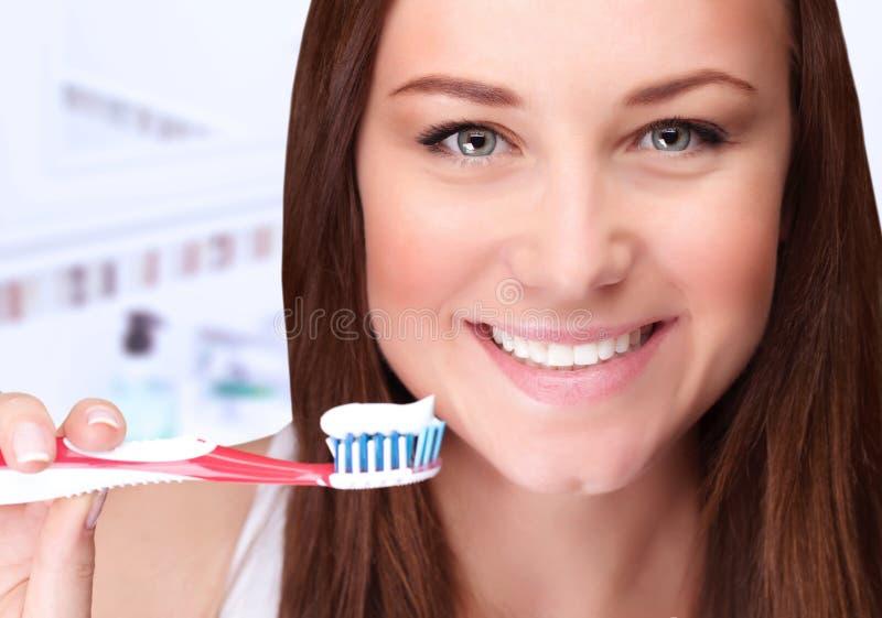 Attractive female clean teeth stock photos