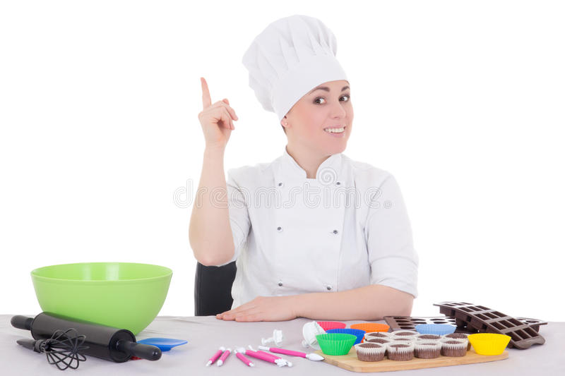 attractive female confectioner in cook uniform sitting at the kitchen isolated on white royalty free stock photography