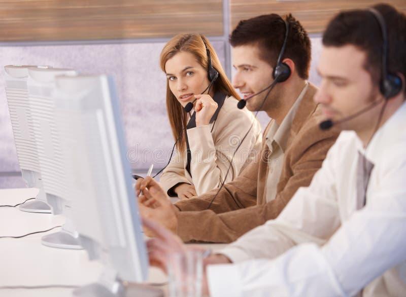 Attractive female customer servicer working