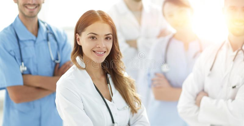Attractive female doctor with medical stethoscope in front of me stock images
