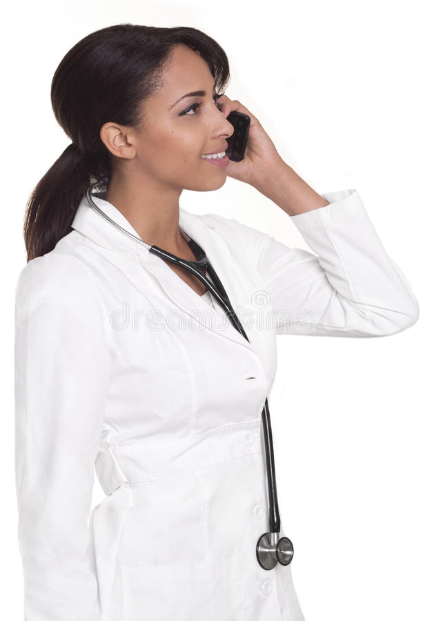 Attractive female doctor on phone stock image