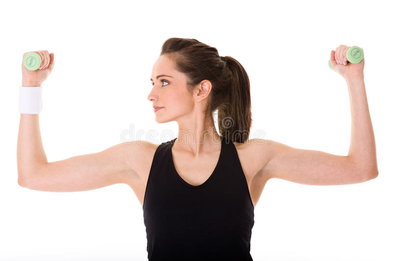 Attractive female exercise using half kilo weights royalty free stock images