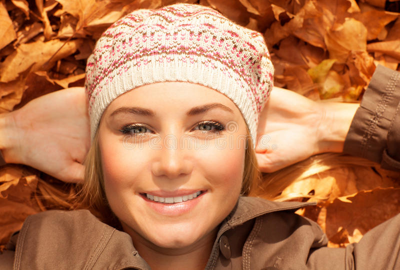 Attractive Female On Fall Foliage Royalty Free Stock Photos