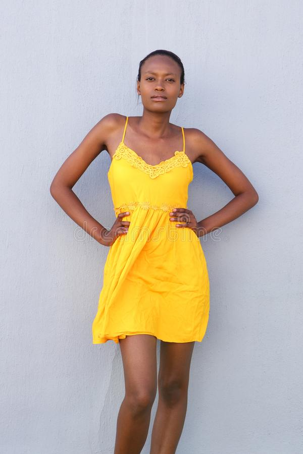 Attractive female fashion model posing in yellow dress royalty free stock photo