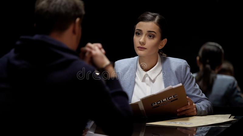 Attractive female lawyer meeting arrested man, preparation for court hearing. Stock photo stock image