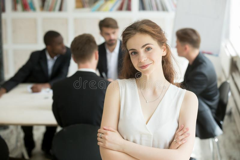 Attractive female leader posing in front of colleagues royalty free stock images