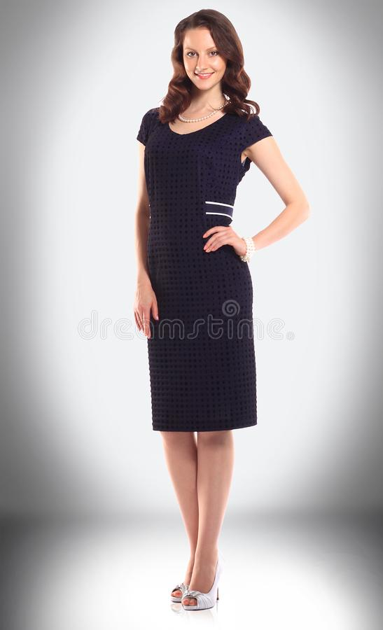 Attractive female model in black elegant dress stock image