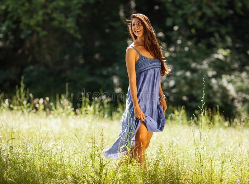 Attractive female model in blue dress. royalty free stock image