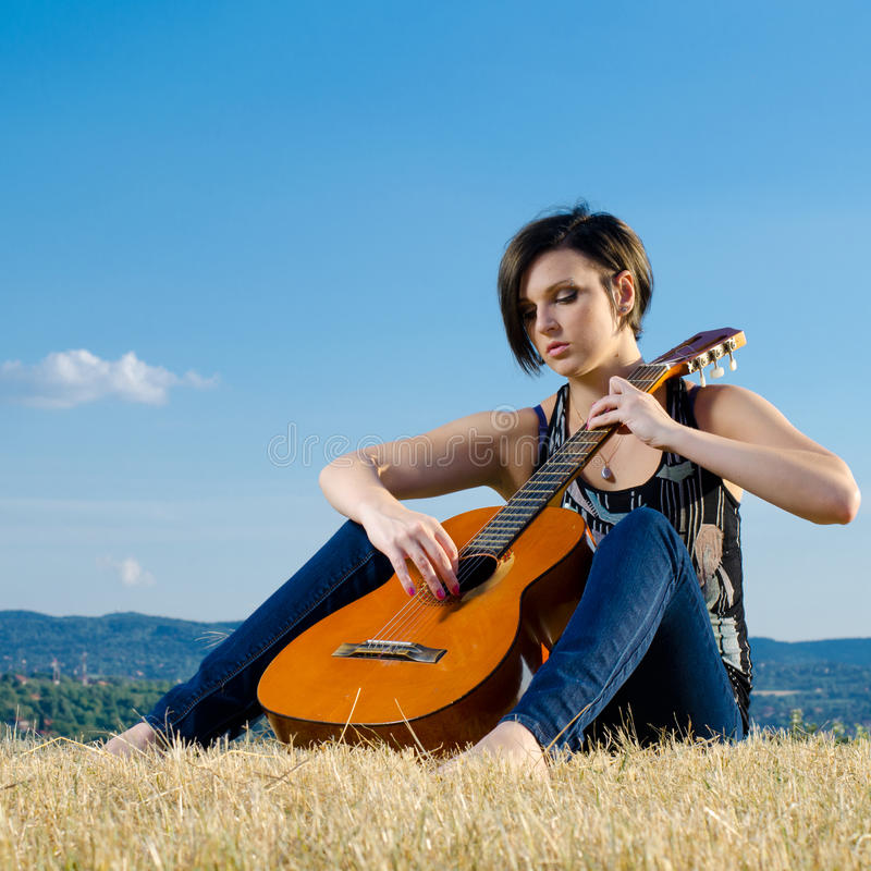 Attractive female musician royalty free stock photography
