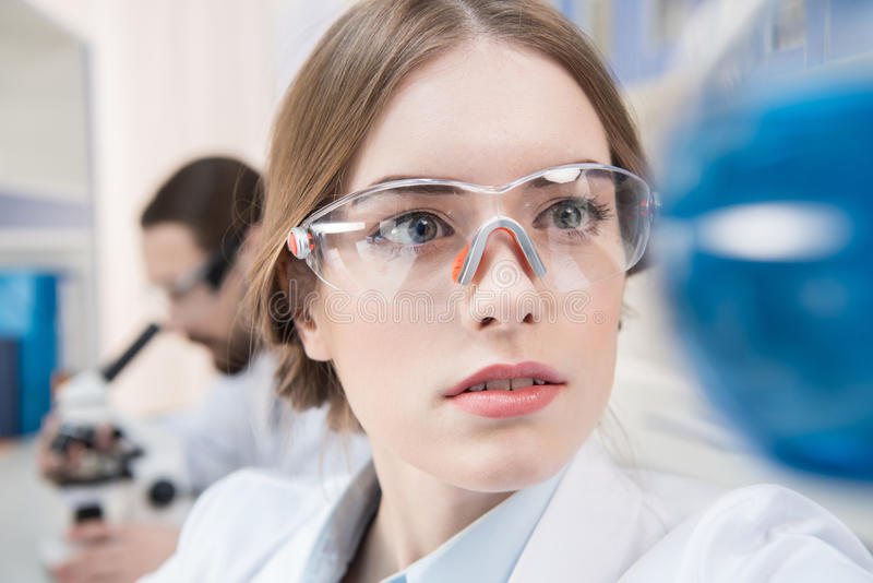 Attractive female scientist stock photo
